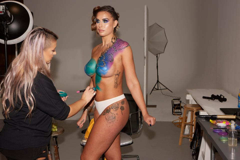 Jessica Shears poses in bright butterfly body paint as she shows off results of 3D liposuction